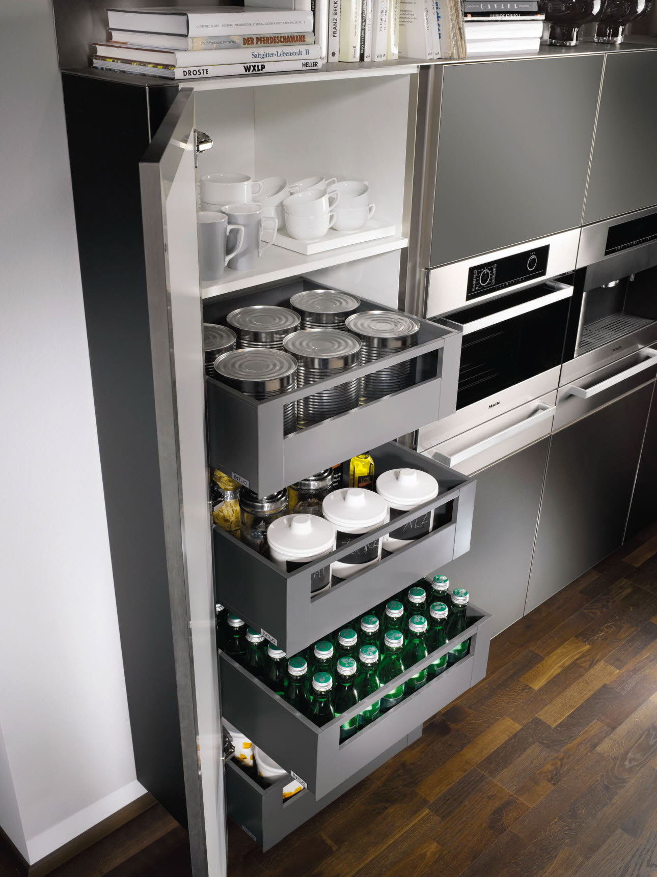 Stock cupboard with interior roller baskets