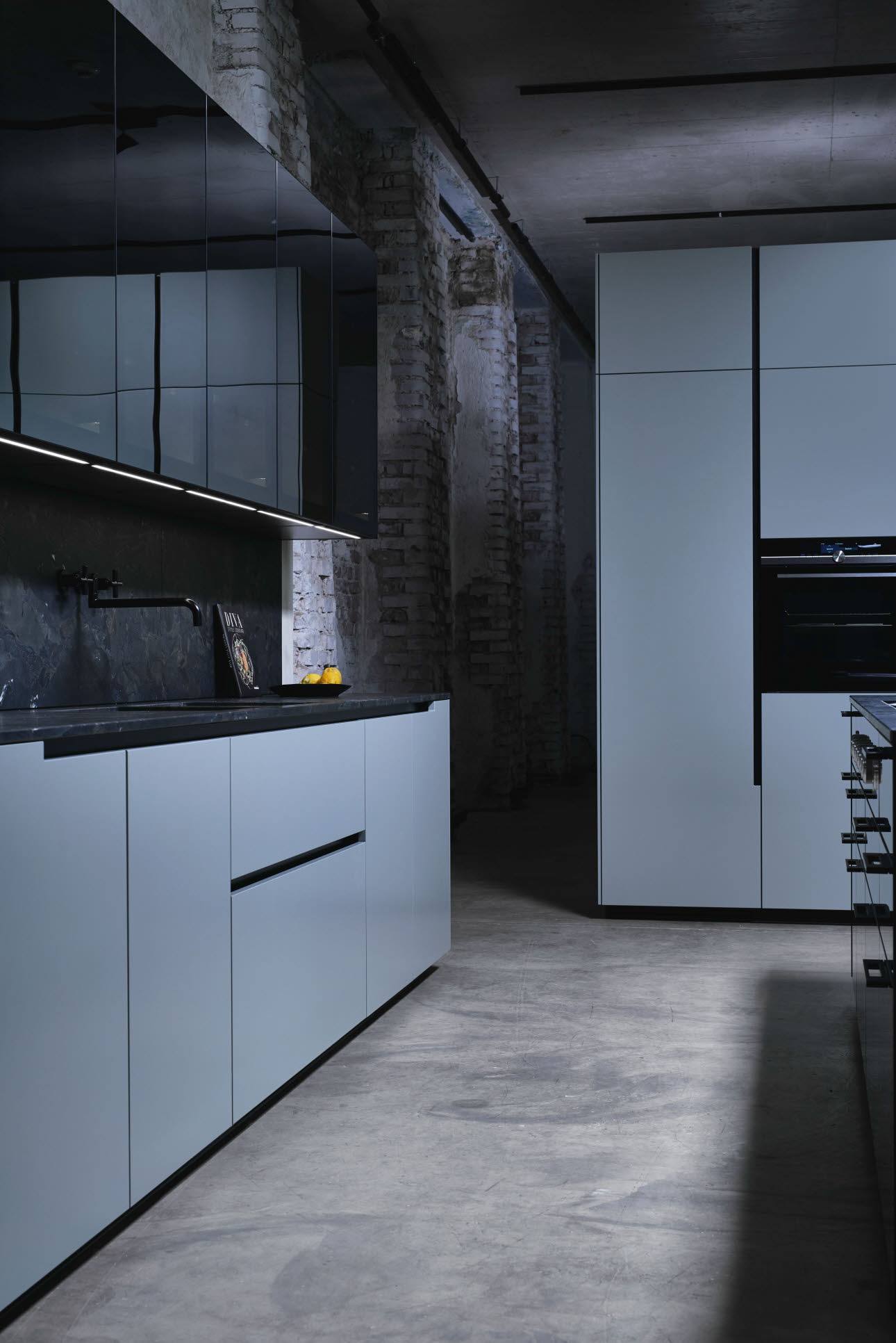 "Modern design kitchen in trend colour ""matcha latte"" with glass fronts"